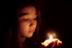 Sabian Symbol for Scorpio 4: A youth holding a lighted candle (in a devout ritual).