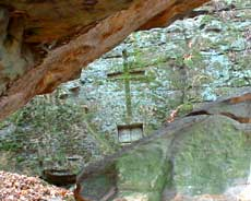 Sabian Symbol for Pisces 07: A cross lying on the rocks