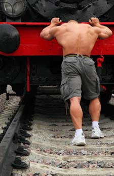 Man pushing a train