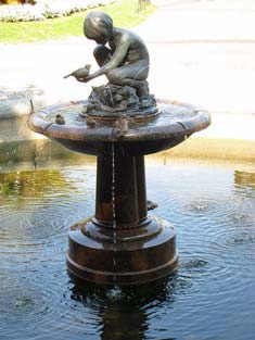 Sabian Symbol for Libra 22: A child giving birds a drink at a fountain .