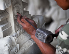 The fine sculptor's touch with a hammer and chisel
