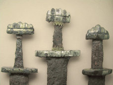Sabian Symbol for Pisces 13: A sword in a museum